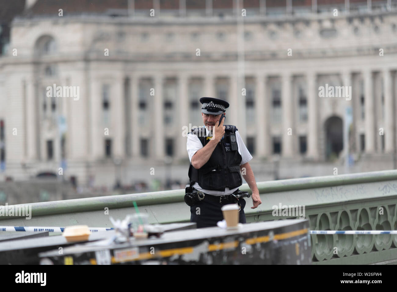 police-have-closed-westminster-bridge-to-vehicle-and-pedestrian-traffic-after-it-was-hit-by-a-city-cruises-vessel-on-the-river-thames-around-1630-fire-brigade-also-in-attendance-the-bridge-will-remain-closed-until-it-has-been-inspected-and-declared-safe-male-officer-reporting-in-W26FW4.jpg