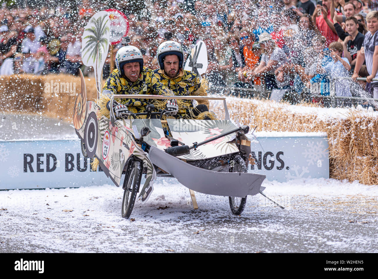 honolulu-healy-competing-in-the-red-bull-soapbox-race-2019-at-alexandra-park-london-uk-jumping-over-ramp-with-people-W2HEN5.jpg