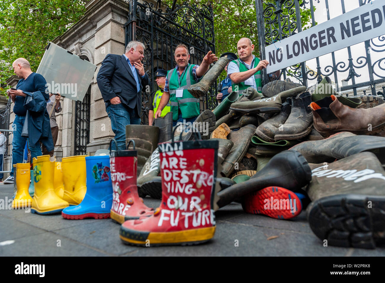 dublin-ireland-10th-july-2019-thousands-of-farmers-descended-on-leinster-house-today-in-protest-at-the-mercosur-deal-which-farmers-claim-will-be-the-final-nail-in-the-coffin-for-their-way-of-life-a-west-cork-beef-farmer-throws-his-wellington-boots-outside-the-dail-to-protest-against-the-proposed-mercosur-deal-credit-andy-gibsonalamy-live-news-W2PRK8.jpg