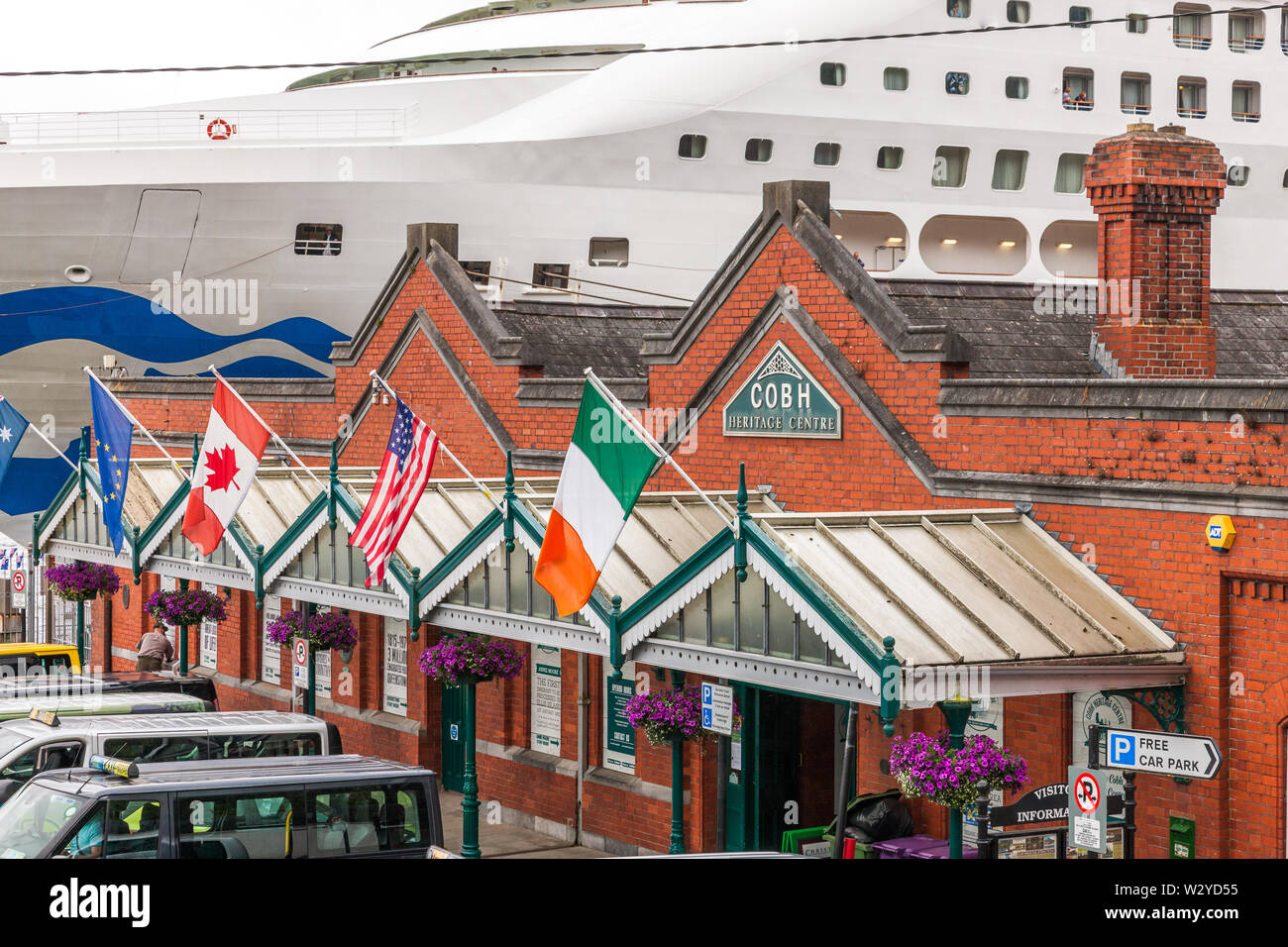 Cobh, Cork, Ireland. 11th July, 2019. The heritage centre on the sea front with the cruise ship Sea Princess docked at the quayside in Cobh, Co. Cork, Ireland. Credit: David Creedon/Alamy Live News Stock Photo