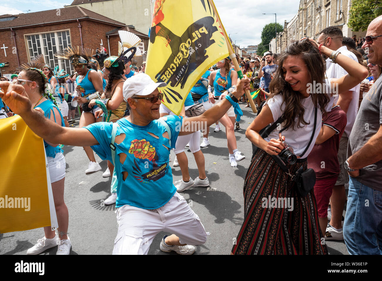 st-pauls-bristol-uk-july-6th-2019-the-51st-st-pauls-carnival-procession-wound-its-way-through-bristols-st-pauls-on-a-hot-and-sunny-saturday-afternoon-the-carnival-attracted-around-100000-people-organised-by-the-st-pauls-carnival-community-interest-company-pictured-man-from-the-procession-persuades-woman-spectator-to-dance-credit-stephen-bellalamy-W36E1P.jpg
