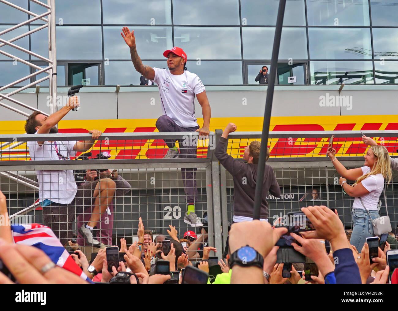 GoTonySmith,HotpixUK,@HotpixUK,Silverstone,Grand Prix,British,F1,Formula One,Formula 1,Formula1,UK,GB,GP F1,fan,fans,Great Britain,Towcester,Northamptonshire,NN12 8TN,2019,waves to fans,waiting at the Pit Lane,after coming first,British Grand Prix,14th July 2019,racing driver,Champion,championship,British flag,flag,sport,Mercedes-AMG,Petronas,AMG,Mercedes Driver,win,winner,mixed race,black driver