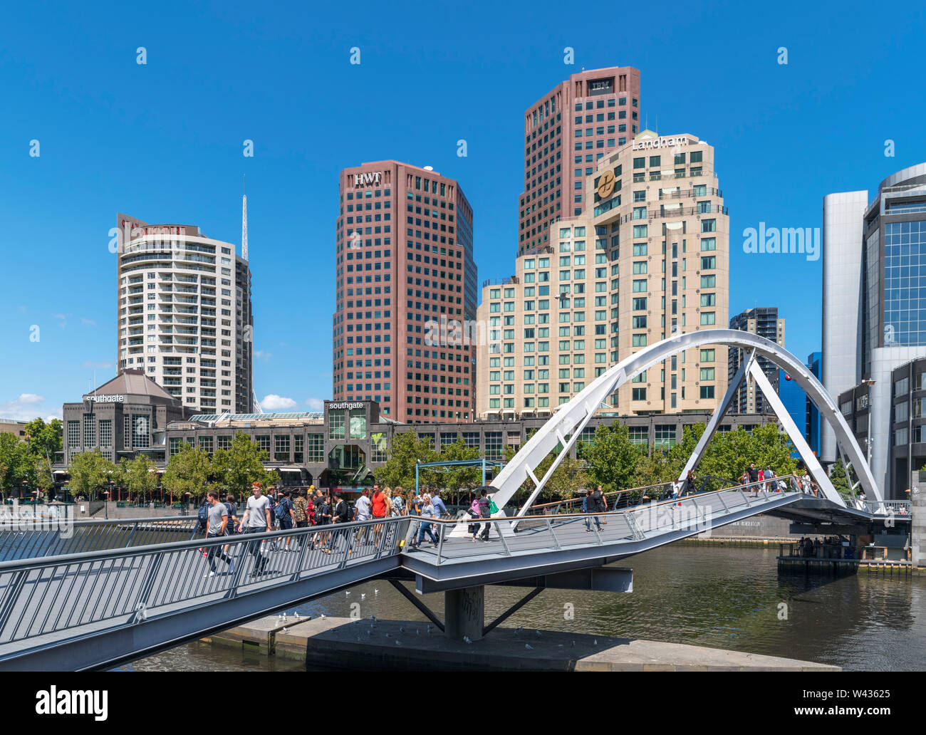 Evan Walker Bridge crossing the Yarra River with the Southgate shopping centre and skyline of Southbank behind, Melbourne, Victoria, Australia Stock Photo