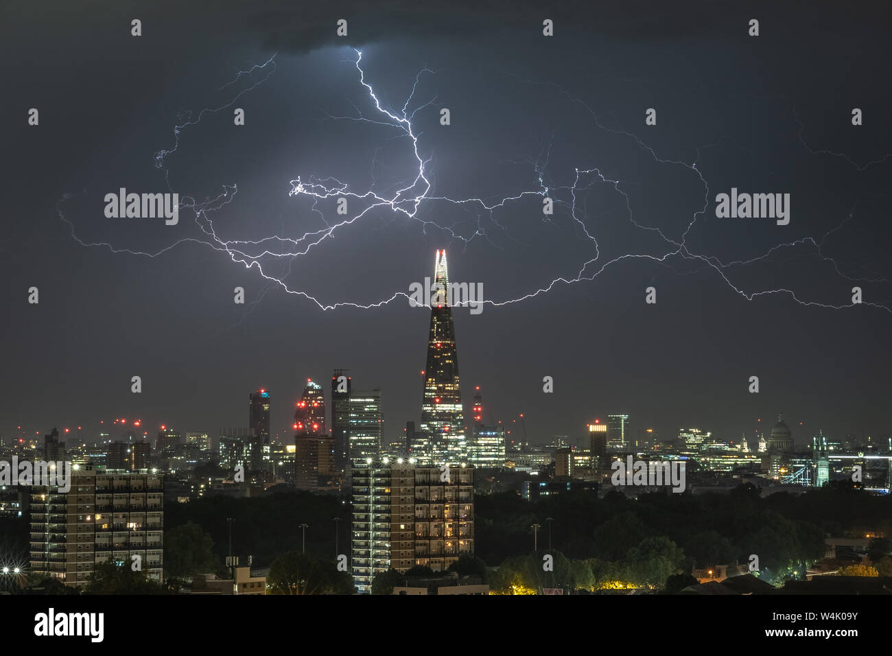 London, UK. 24th July, 2019. UK Weather: Dramatic multiple lightning strikes over The Shard skyscraper building in the early hours of Wednesday. Credit: Guy Corbishley/Alamy Live News Stock Photo
