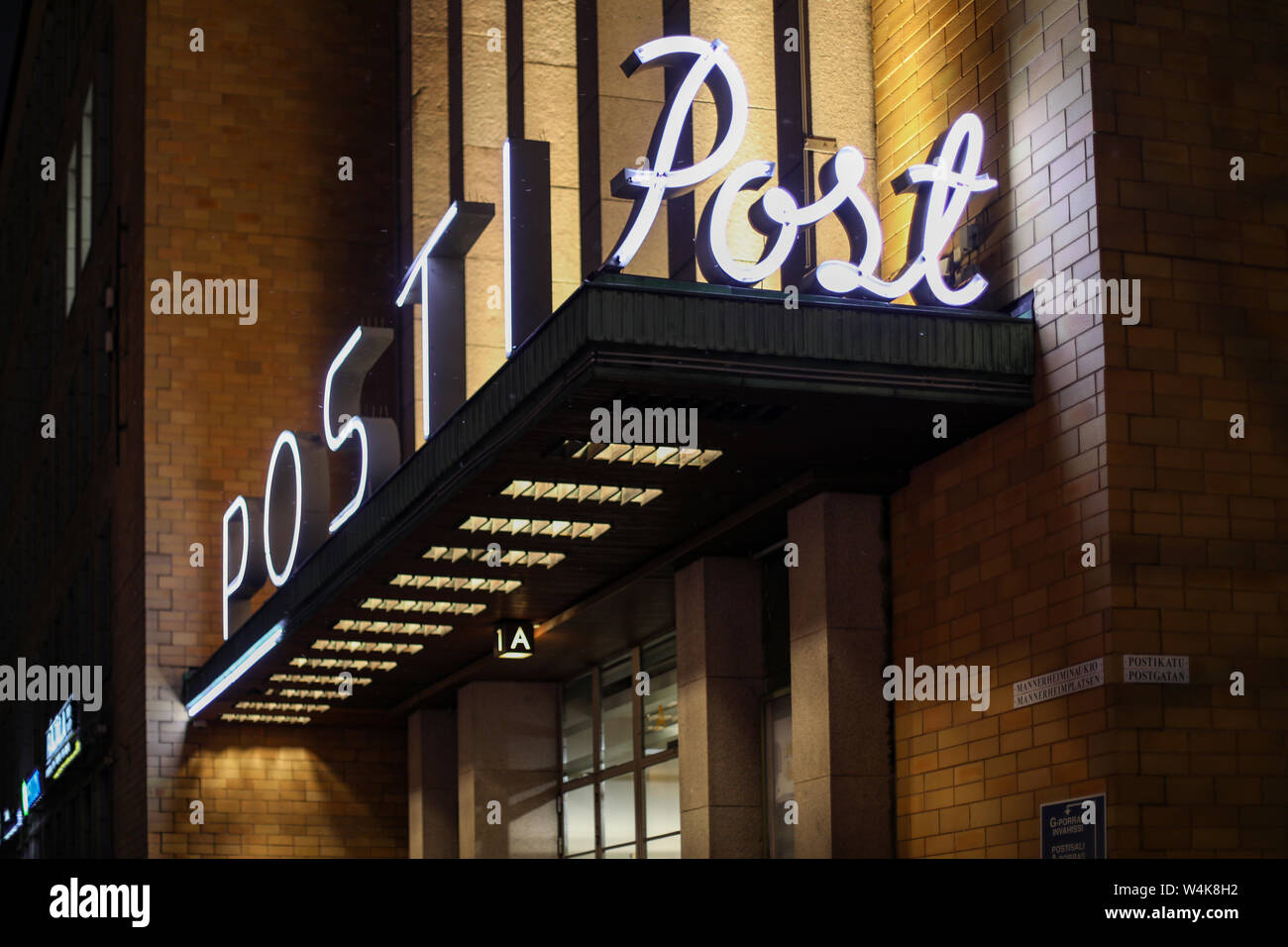 Neon lights of Postitalo - former HQ of Finnish Post Ltd - in Helsinki, Finland Stock Photo