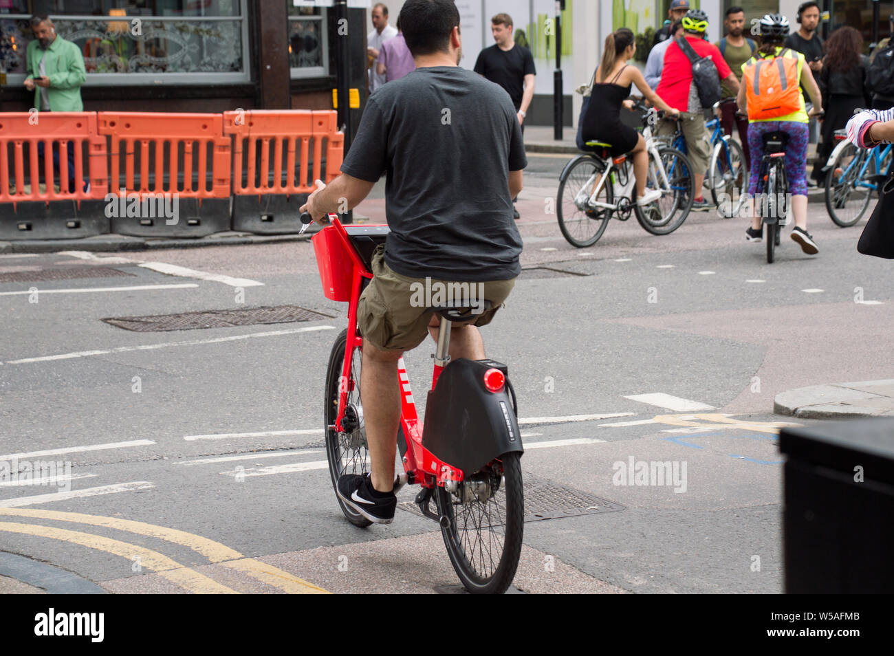 A young man riding Jump bike share in London Old Street Stock Photo
