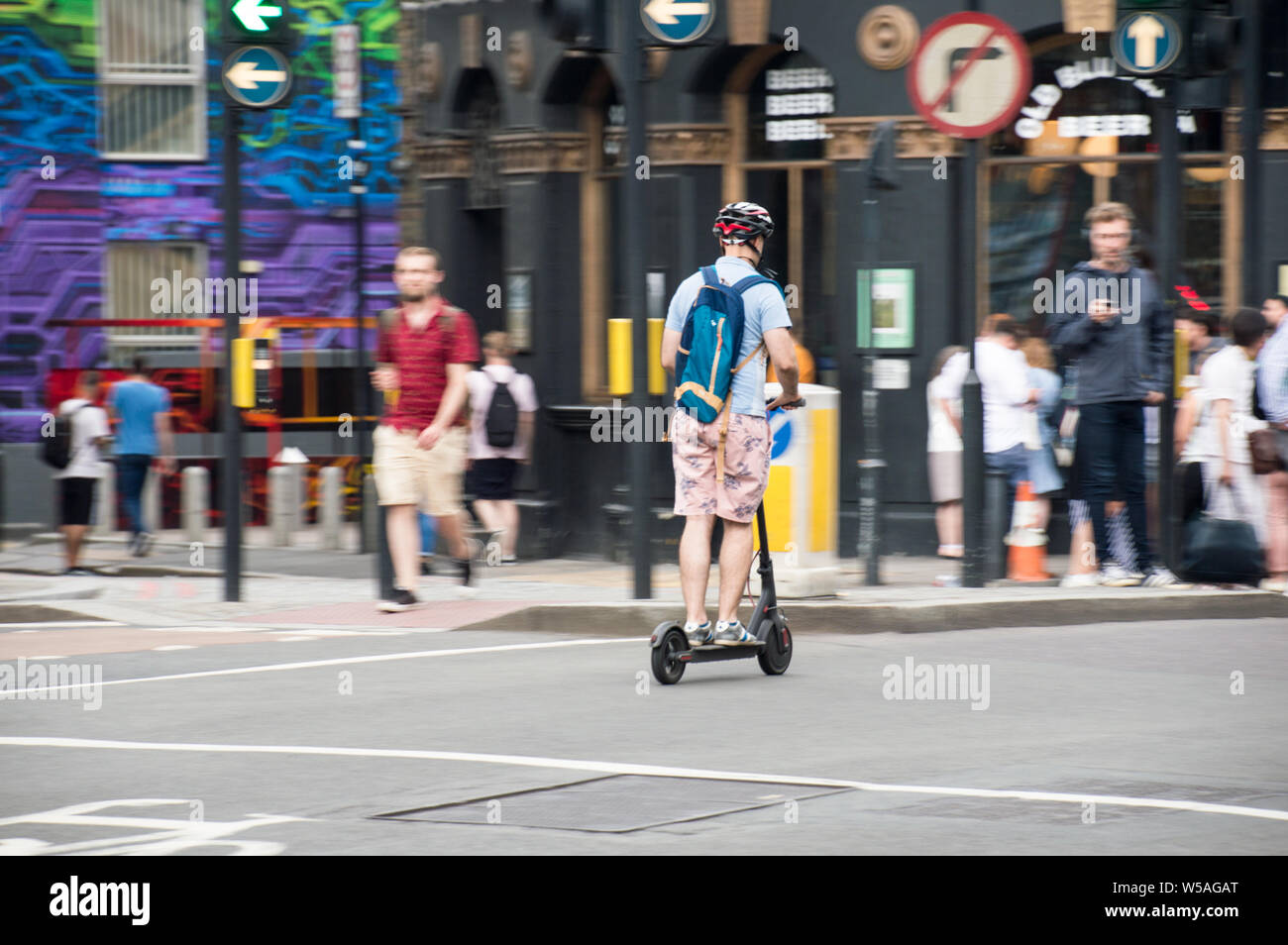man-riding-on-electric-scooter-in-london