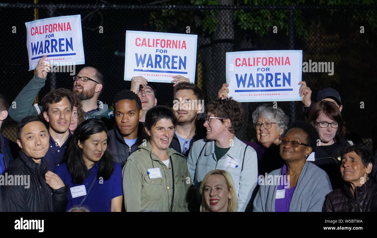 "Elizabeth Warren for United States President rally, Oakland, California, May 31, 2019.  Campaign volunteers holding ""California for Warren"" signs. Stock Photo"