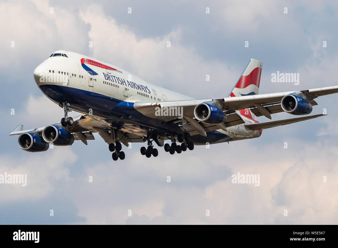 LONDON / UNITED KINGDOM - JULY 14, 2018: British Airways Boeing 747-400 G-CIVU passenger plane landing at London Heathrow Airport Stock Photo
