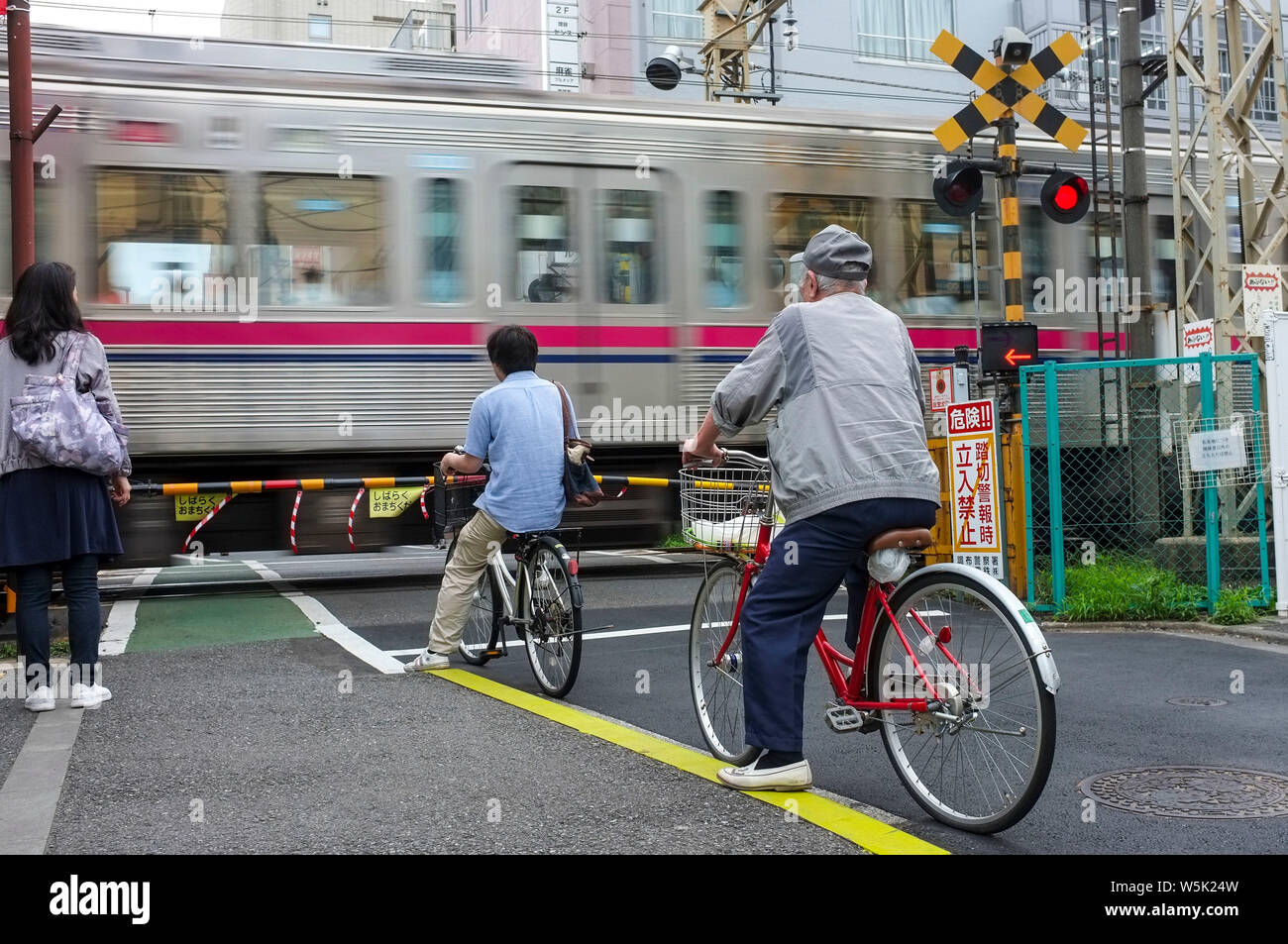 people-on-bicycles-and-pedestrian-stoppe
