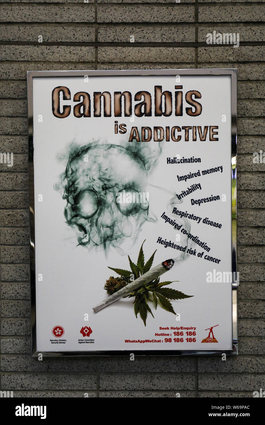Warning poster about the dangers of cannabis in metro station in Hong Kong Stock Photo