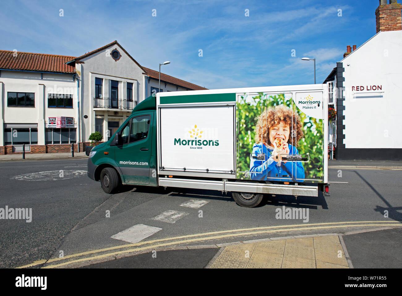 morrisons-delivery-van-in-market-weighton-east-yorkshire-england-uk-W71R55.jpg