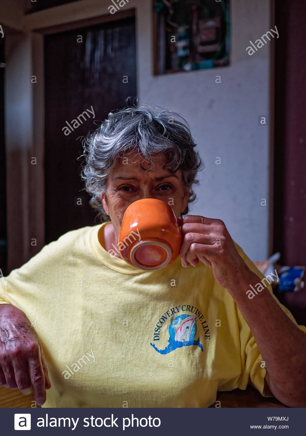 Paquita drinking coffee.  She was the mother of a Nicaraguan lawyer who was the father of Reynaldo (photo also available). Stock Photo