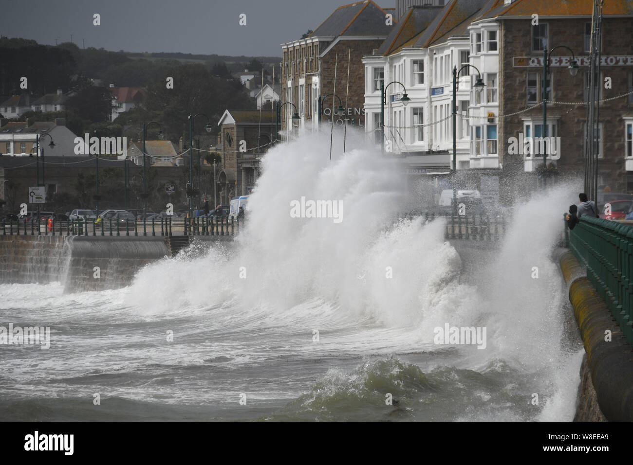 Penzance, Cornwall, UK. 9th August 2019. UK Weather. Strong winds and huge waves batter the seafront at Penzance this lunchtime. Credit SImon Maycock / Alamy Live News. Stock Photo