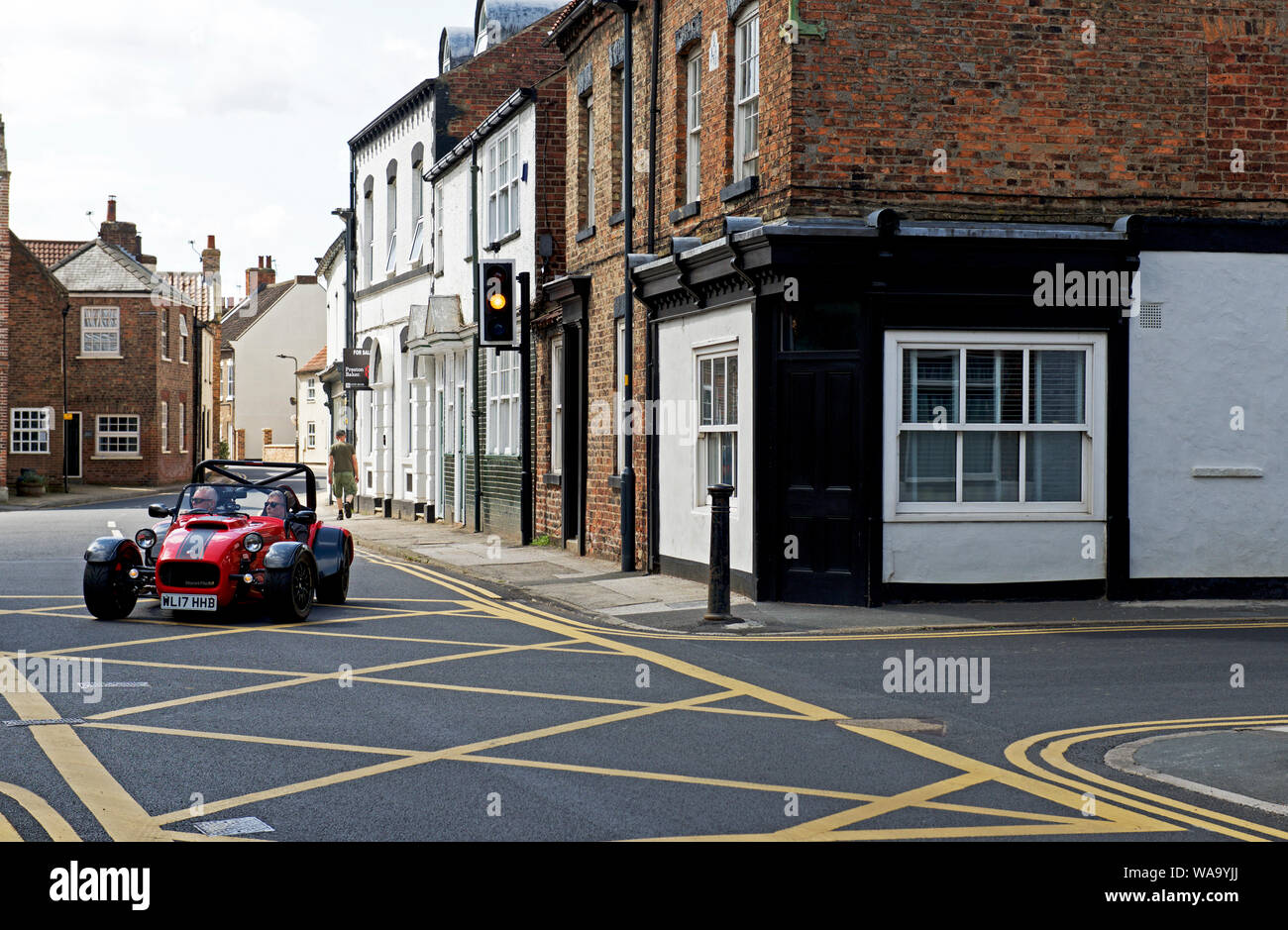 Yellow box junction in the village of Cawood, North Yorkshire, England UK Stock Photo