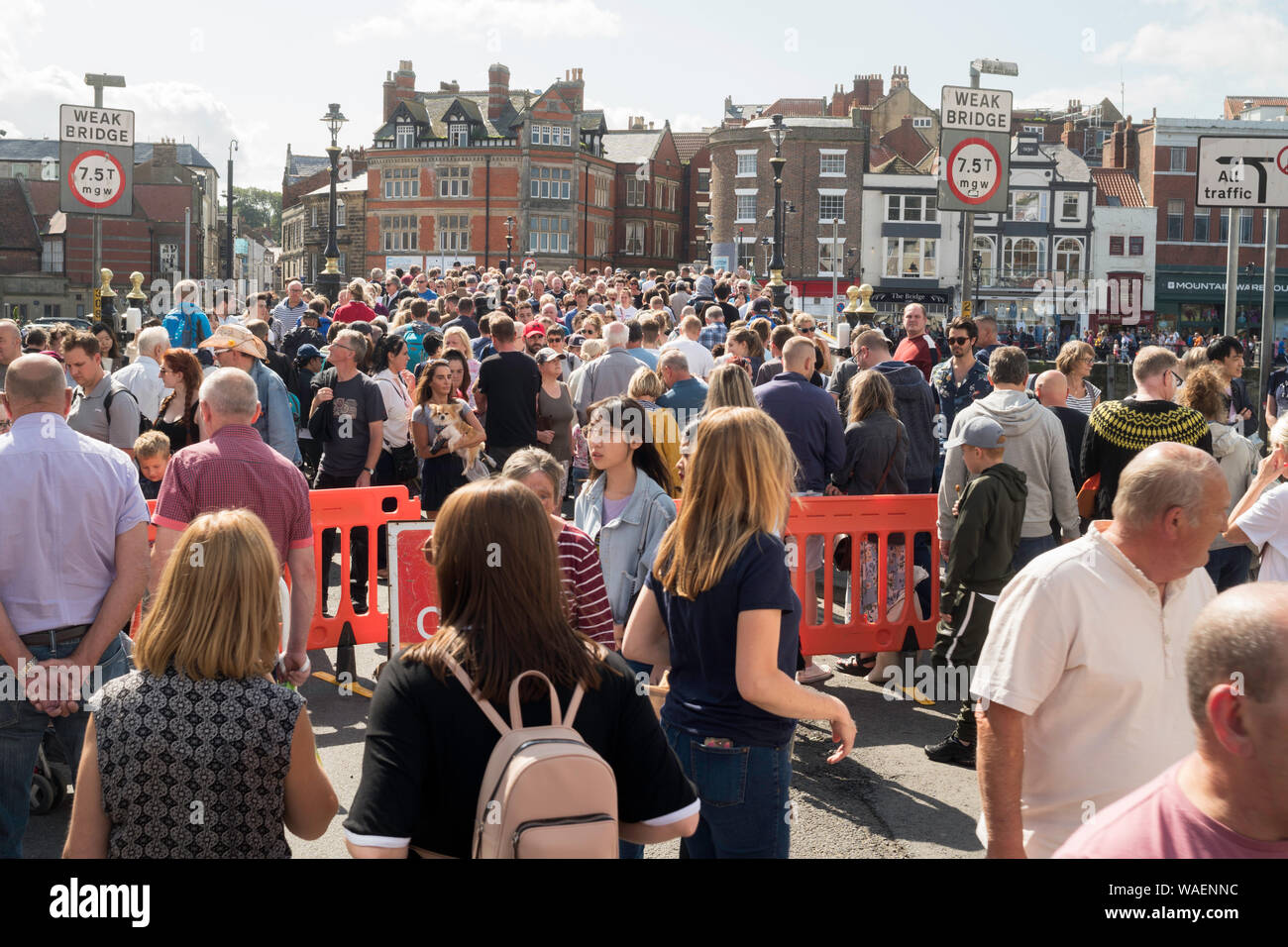 crowds-of-people-crossing-the-swing-brid