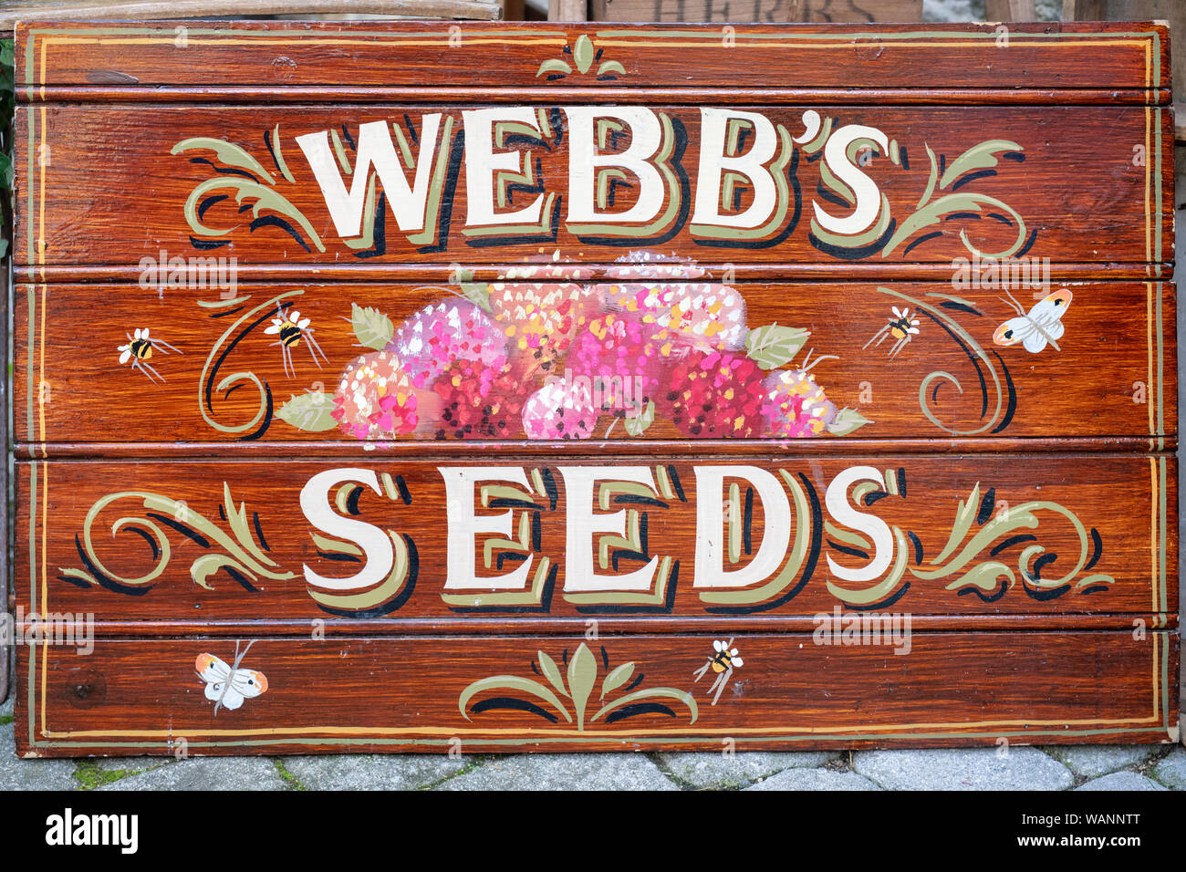 Vintage hand painted wooden seed sign outside a shop in Stow on the wold, Cotswolds, Gloucestershire, England Stock Photo