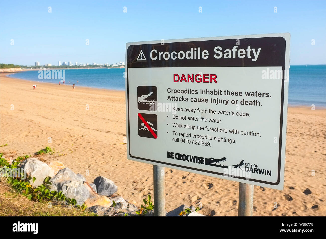 crocodile-warning-sign-on-the-beach-of-e