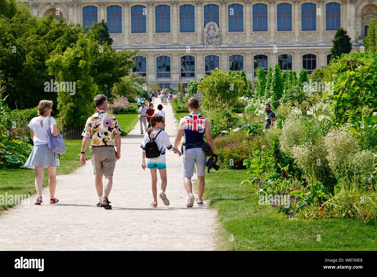 family-on-vacation-walking-towards-the-m