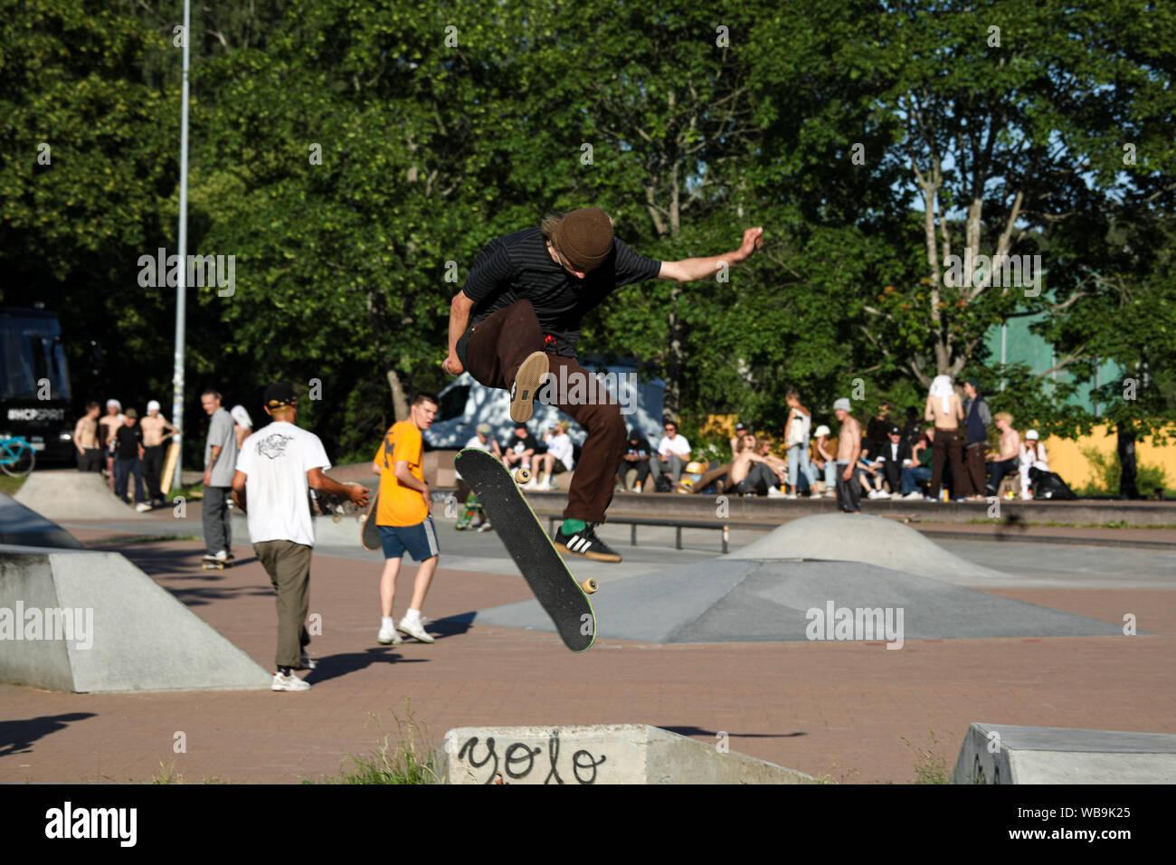 Motion freeze in the middle of a skateboard trick Stock Photo