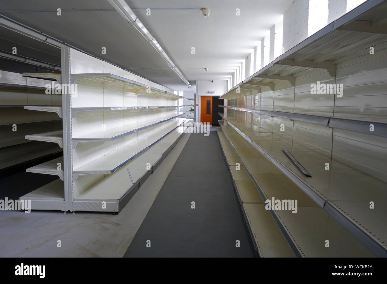 Empty shelves of a closed supermarket that is for sale, Stoke-on-Trent, Staffordshire, England, UK Stock Photo