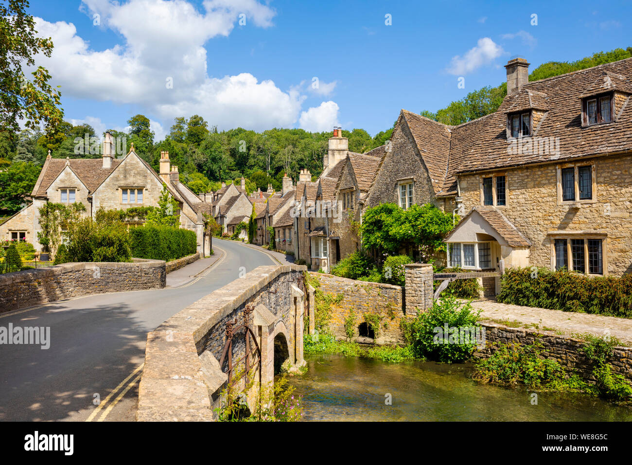 Castle Combe Water lane with bridge over the By brook on to The Street Castle Combe village Castle Combe Cotswolds Wiltshire england gb uk Europe Stock Photo