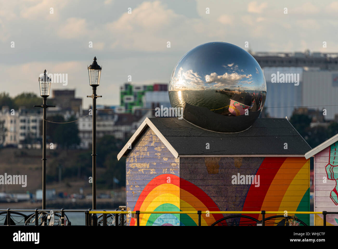 chrome-globe-on-a-multi-coloured-rainbow-hut-on-southend-pier-southend-on-sea-essex-uk-mirror-ball-reflecting-thames-estuary-campus-accomodation-WHJCTF.jpg