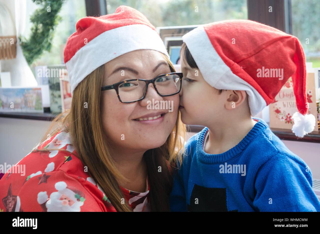son-kissing-mother-during-christmas-WHMCWM.jpg