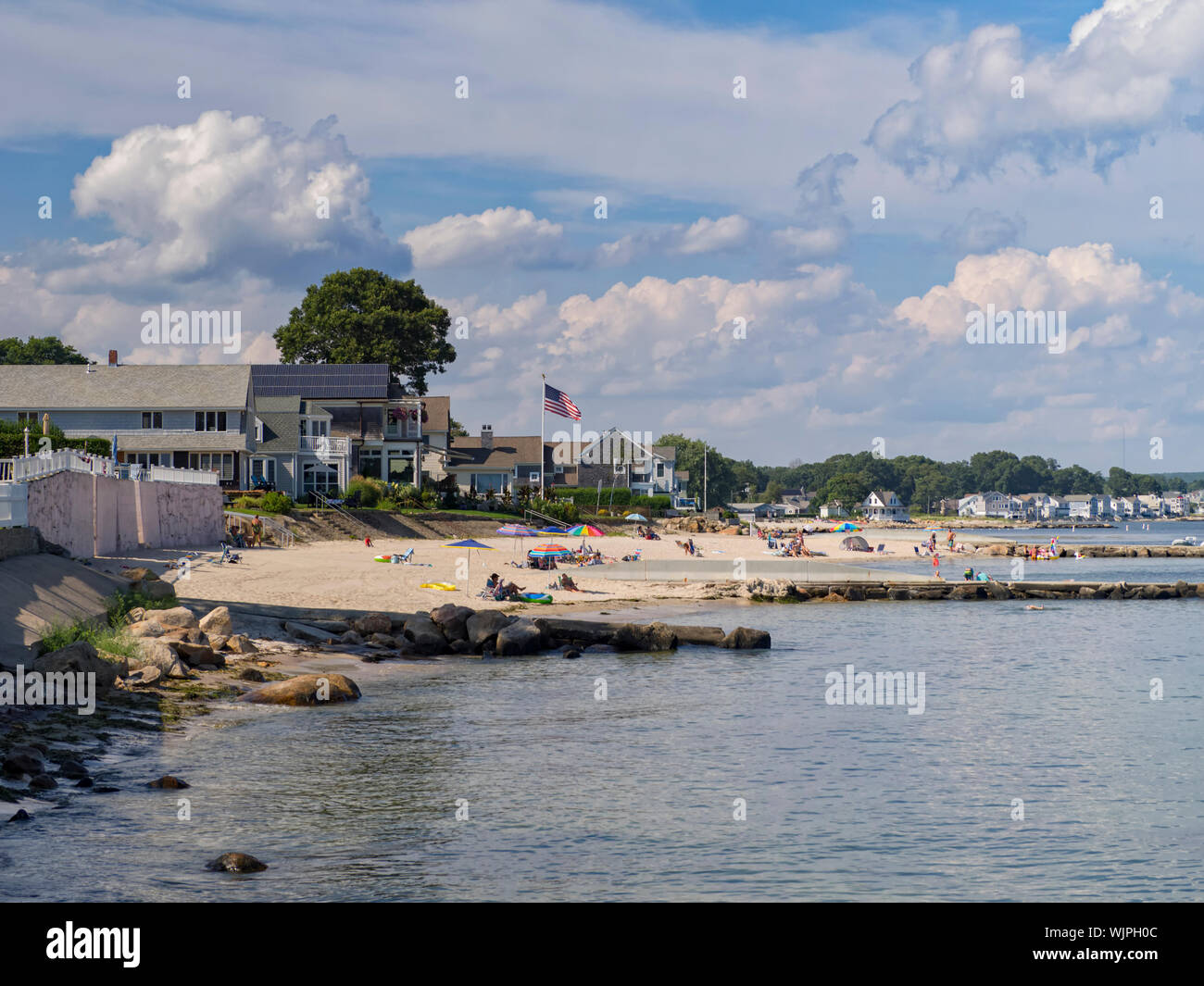 niantic-connecticut-usa-aug-22-2019-residents-of-this-new-england-small-town-and-vacationers-enjoy-a-summer-day-by-the-sea-at-black-point-beach-WJPH0C.jpg