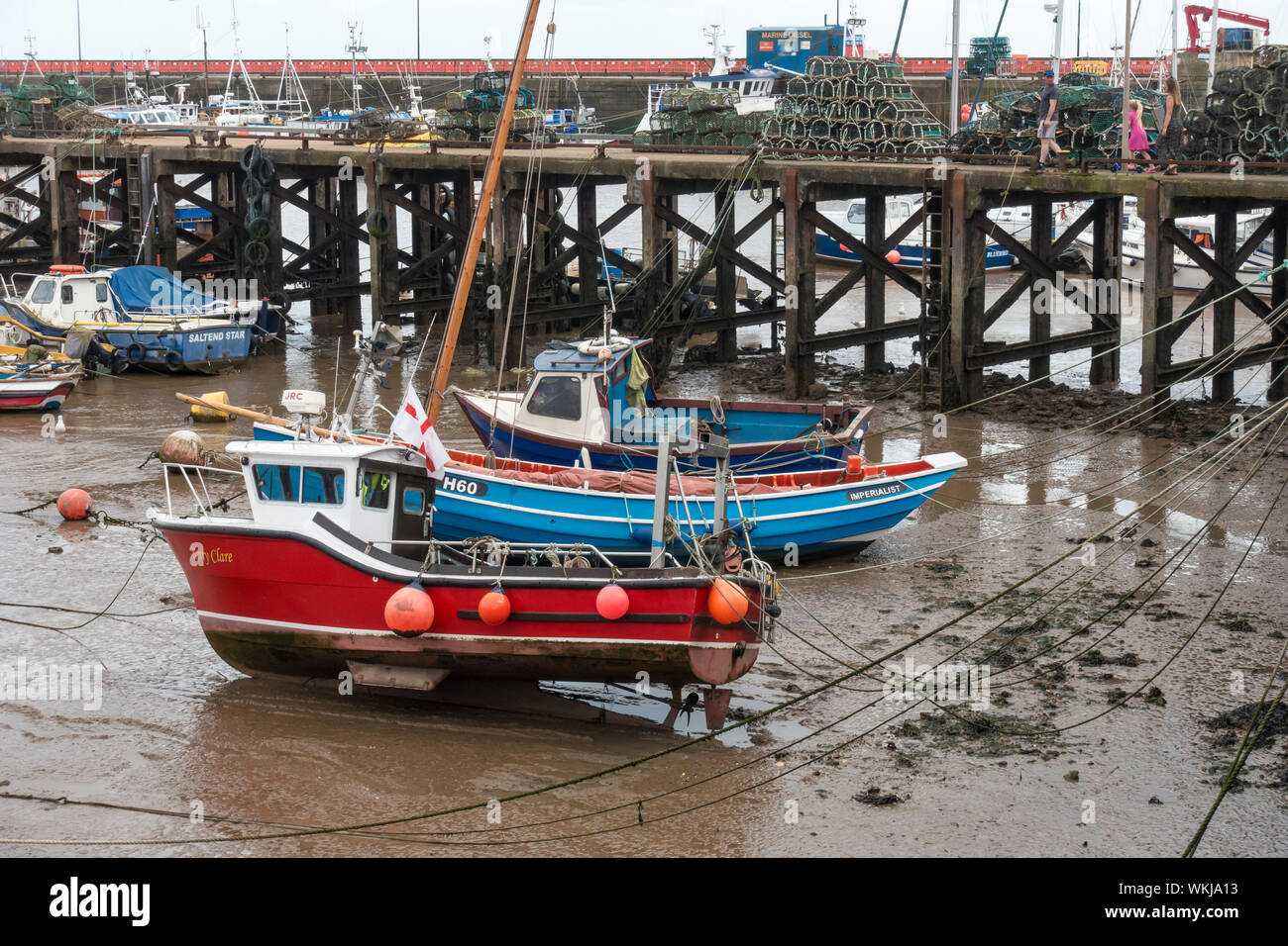 Fishing boats resting on mud at low tide Bridlington harbour East Yorkshire 2019 Stock Photo