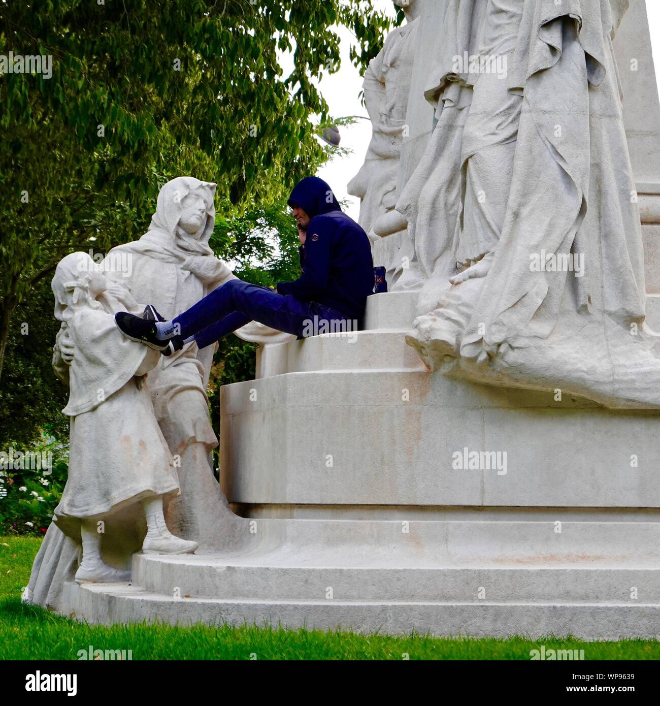 young-man-sitting-on-a-monument-to-ludov