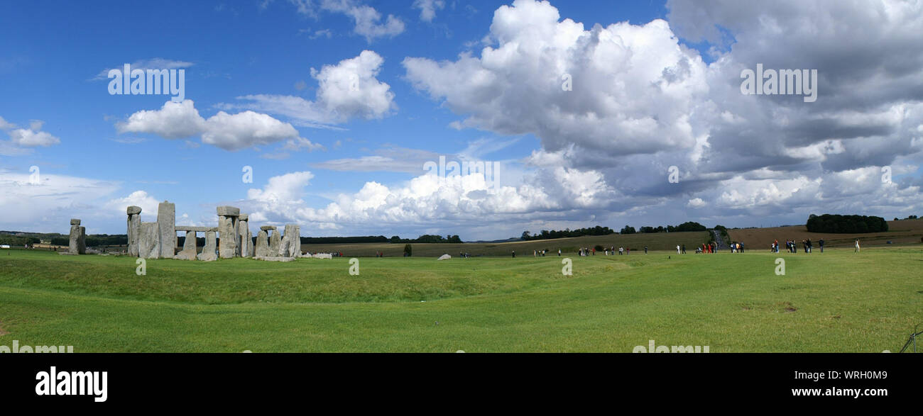 Panoramic View Of Houses On Field Against Sky Stock Photo