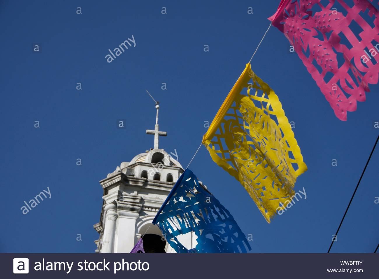La iglesia de Santa Ana, Church of Santa Ana, el barrio de Perslvillo. La Delegación Cuauhtémoc. Papel picado (cut paper flags). Mexico City, Mexico. Stock Photo