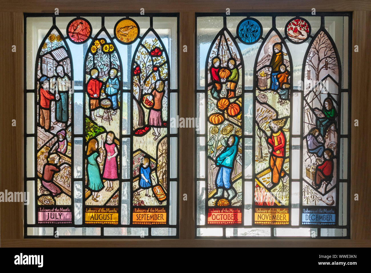 stained-glass-window-depicting-labours-of-the-month-on-display-in-godalming-museum-surrey-uk-WWE3KN.jpg