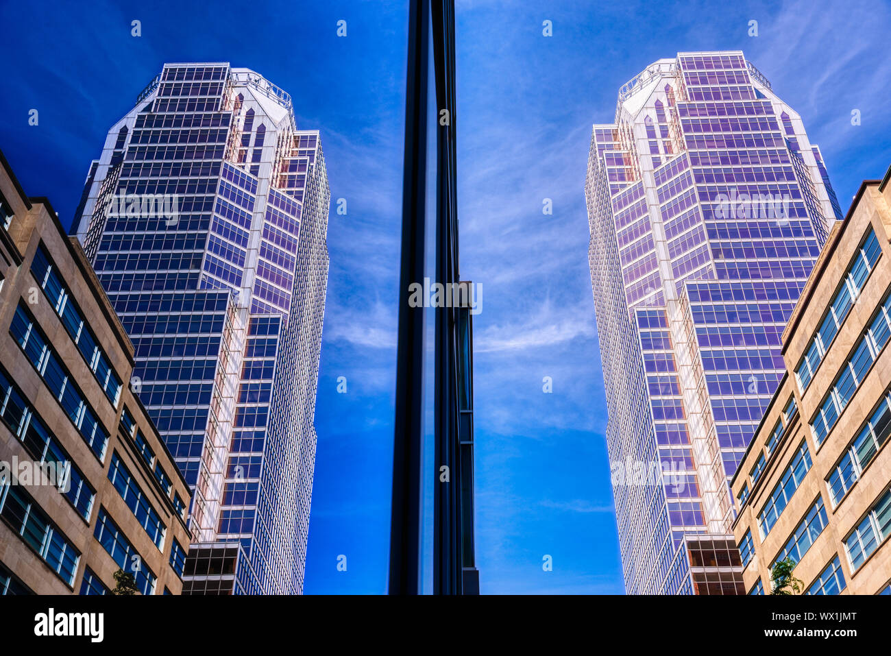 The KPMG Building reflected in the glass walls of the BNP Paribas Building, boulevard Maisonneuve, Montreal Stock Photo