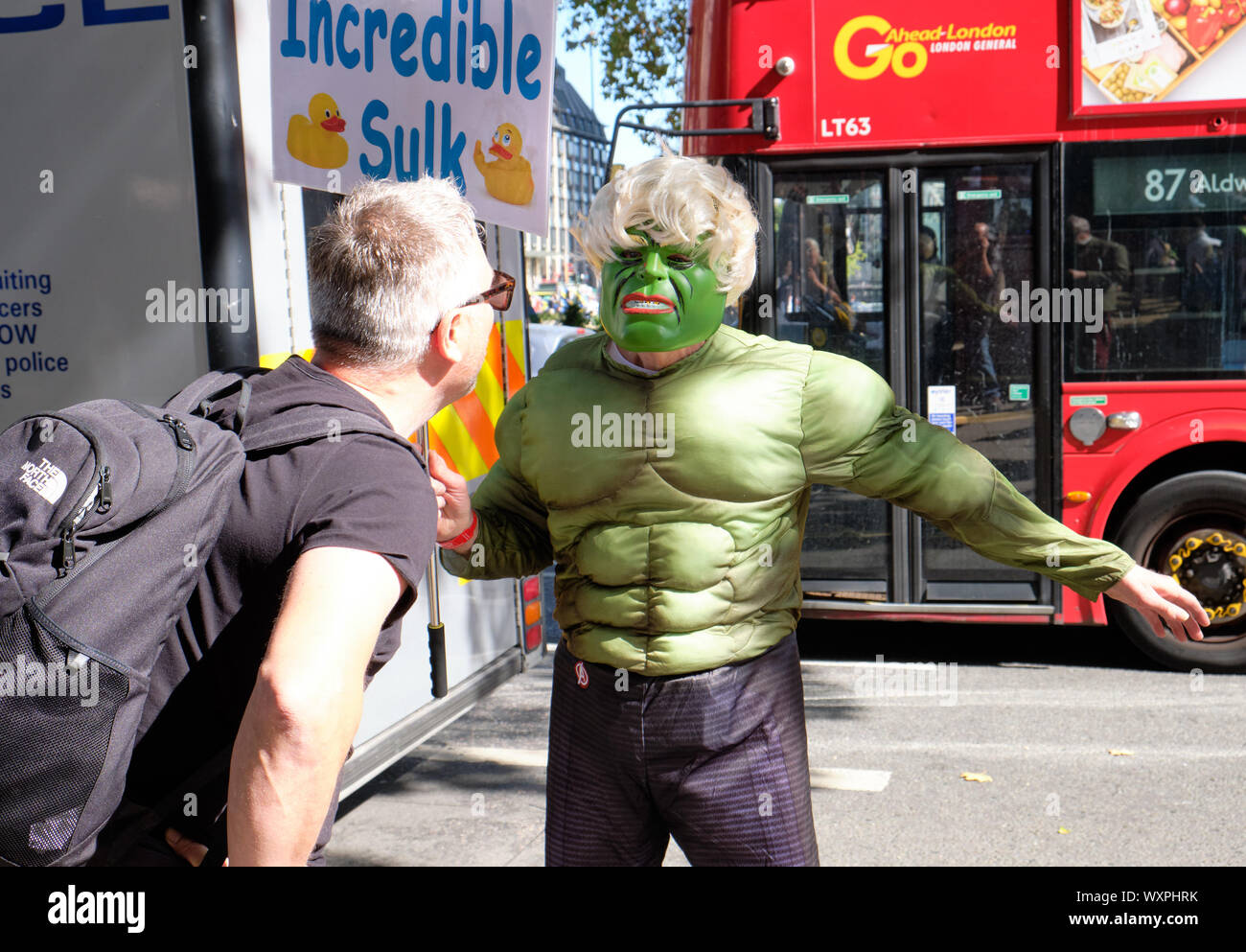 pro-remain-supporters-in-hulk-costume-with-incredible-sulk-sign-in-front-on-supreme-court-in-london-confronted-by-a-leave-supporter-WXPHRK.jpg