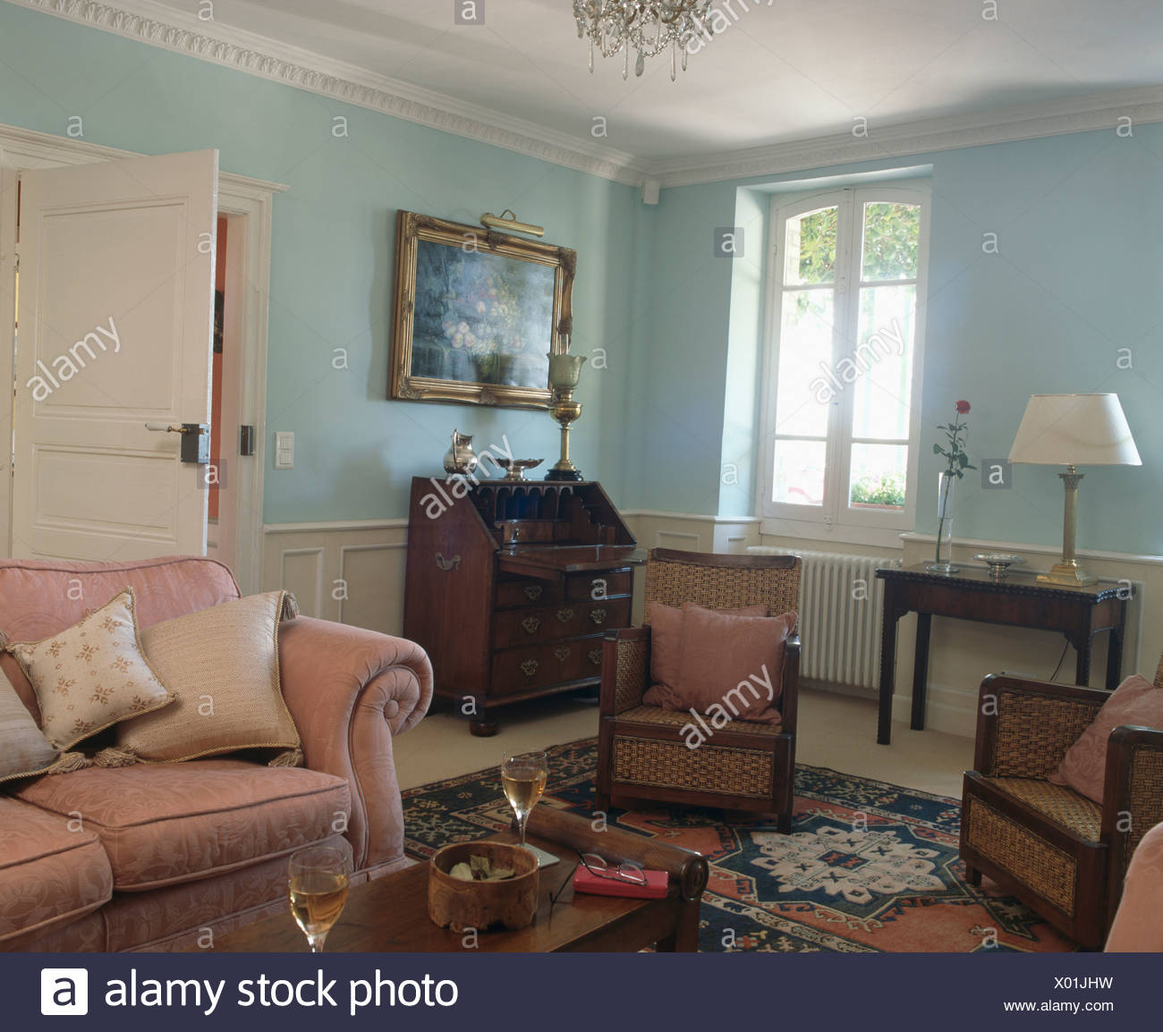Pink sofa and English antique furniture in pastel blue French country  living room - Pink Sofa And English Antique Furniture In Pastel Blue French