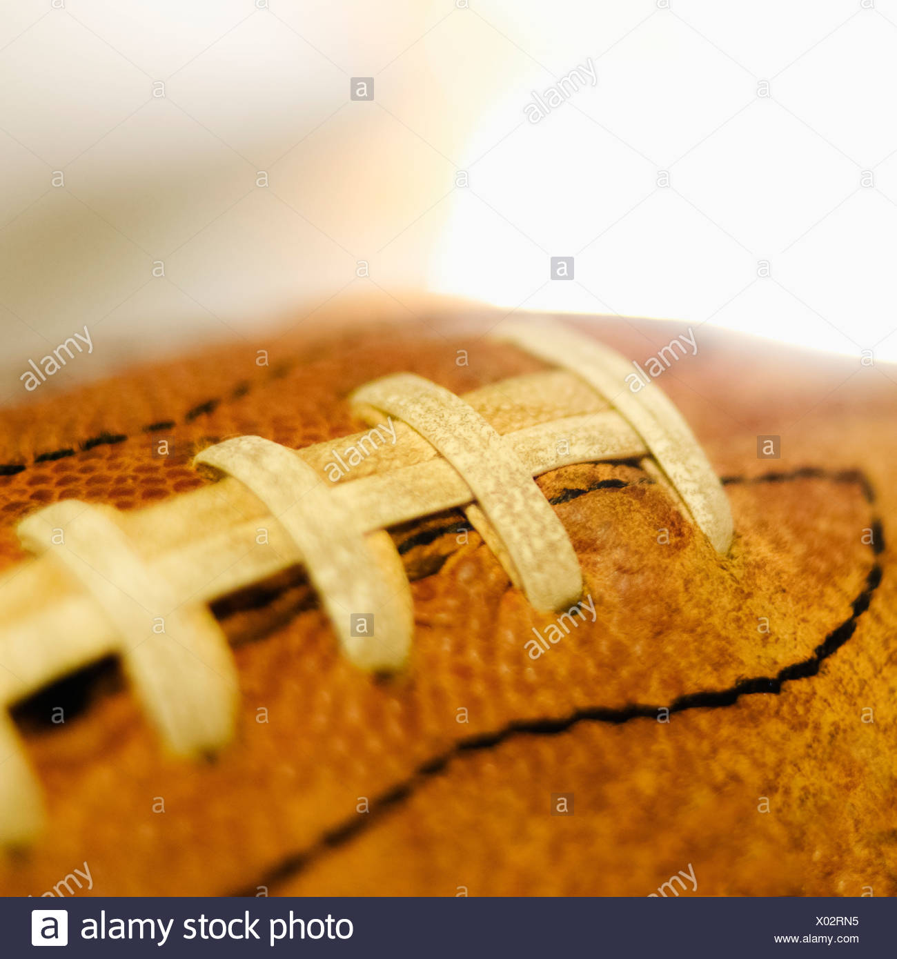 Studio shot of old football - Stock Image