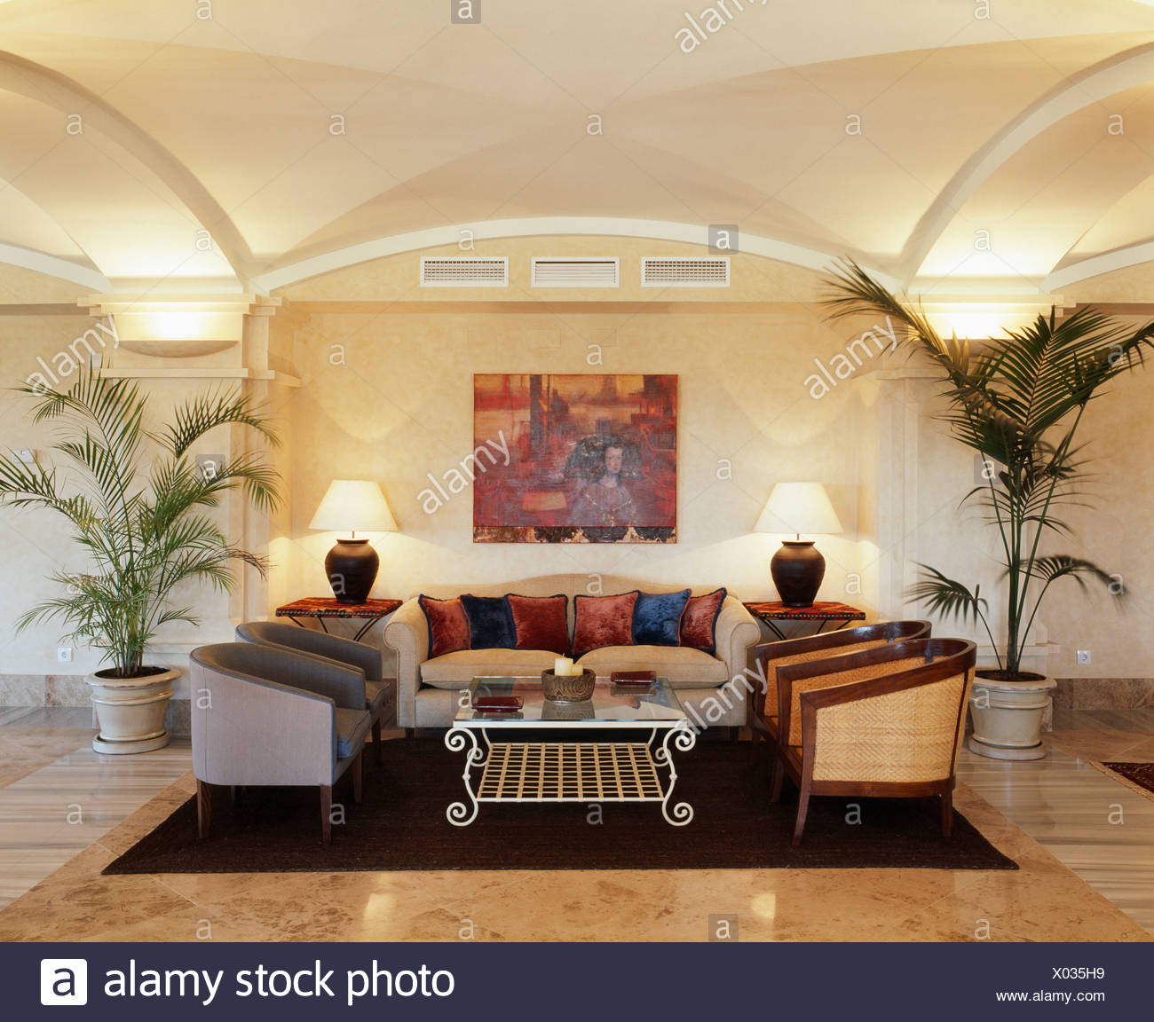 Bon Comfortable Sofa And Armchairs In Modern Spanish Living Room With Potted  Palms And Lighted Lamps And Wall Lights