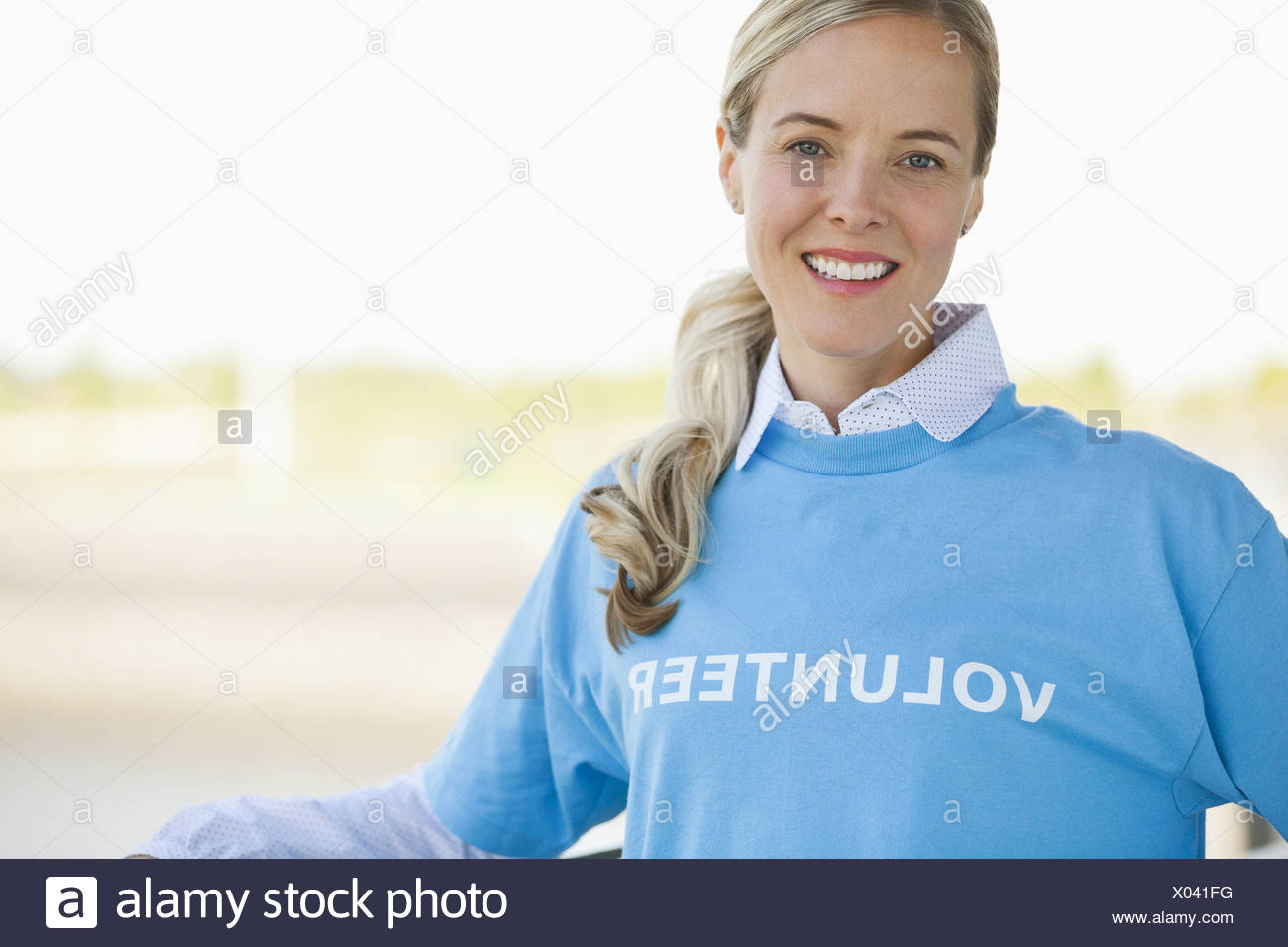 Portrait of beautiful volunteer outdoors - Stock Image