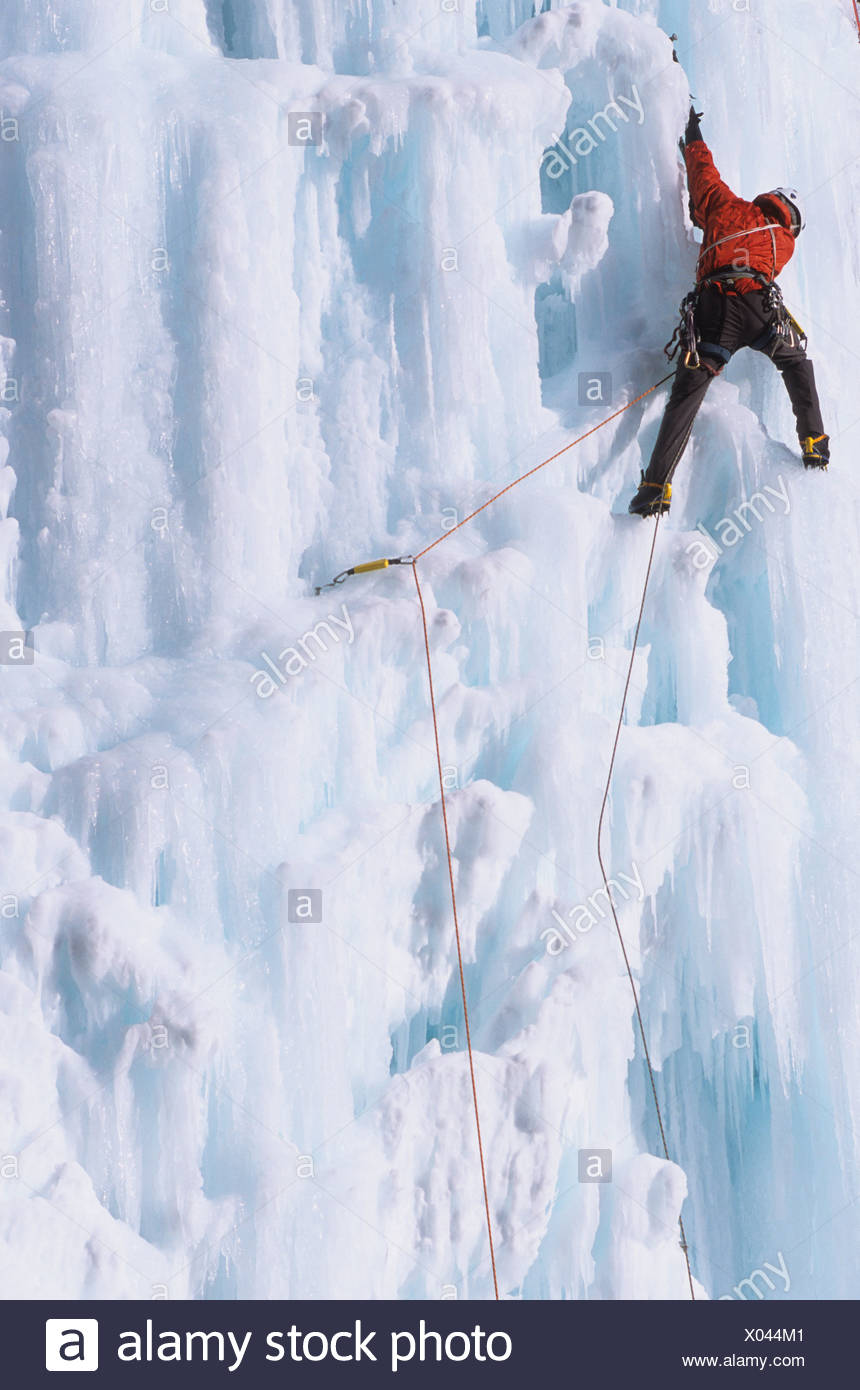 An ice climber ascending the Malignant Mushroom, WI 5, Ghost River, Alberta, Canada - Stock Image