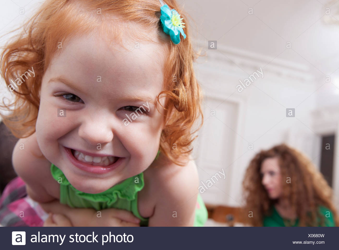 Germany, Berlin, Girl having fun at home, woman in background - Stock Image