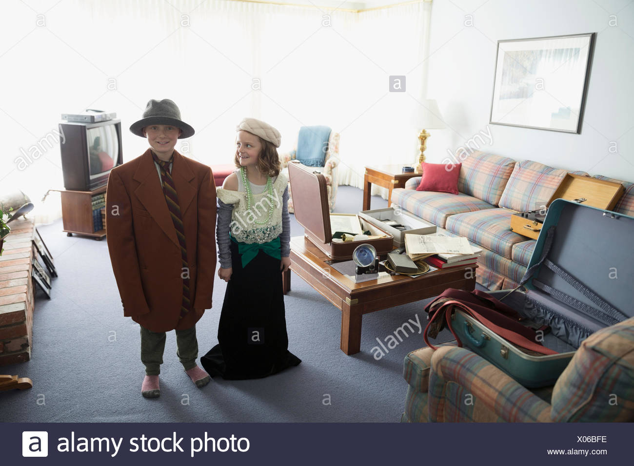 Portrait brother and sister in old-fashioned clothing - Stock Image
