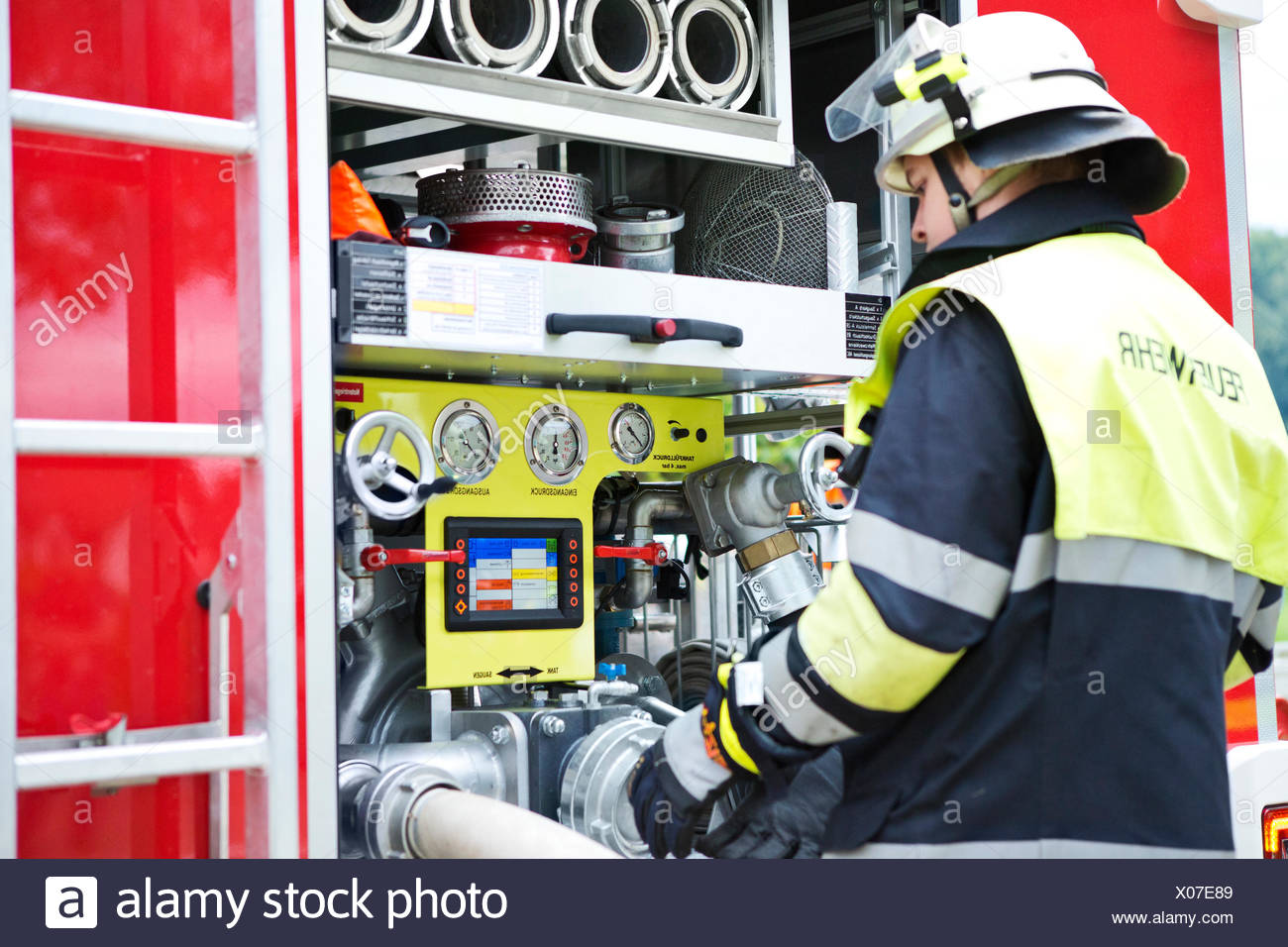 Firefighter at fire engine - Stock Image