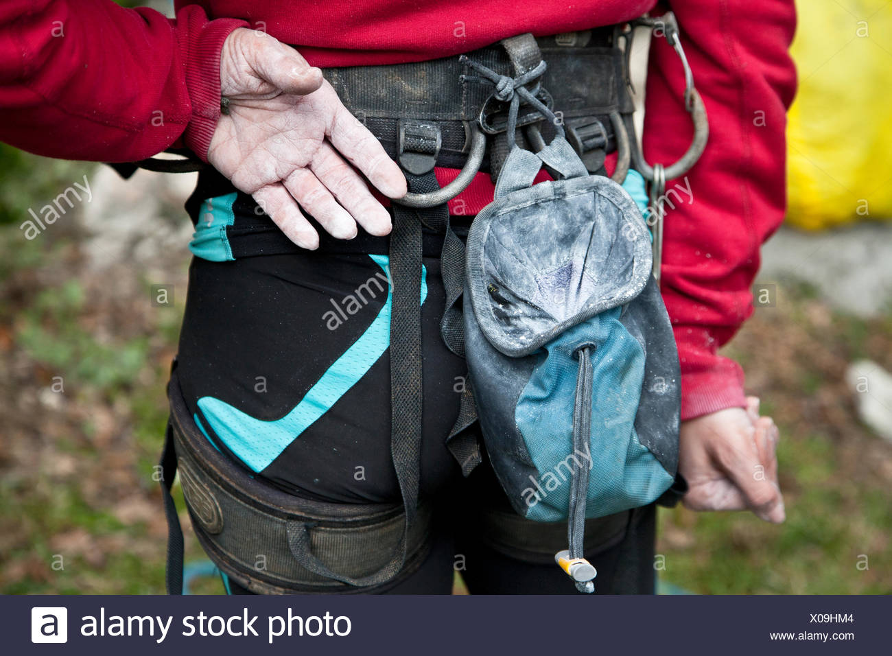 Italy, Midsection of female rock climber - Stock Image