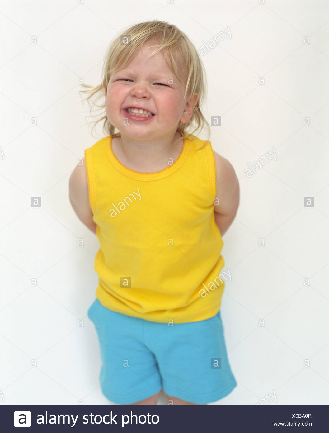 little girl with cheeky expression - Stock Image