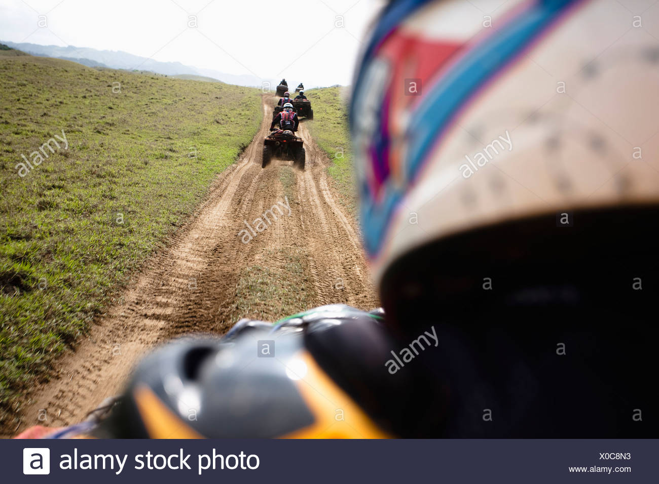 A group of man rides their quads through a dirt road from Catemaco to Coatzacoalcos in Veracruz, Mexico. - Stock Image