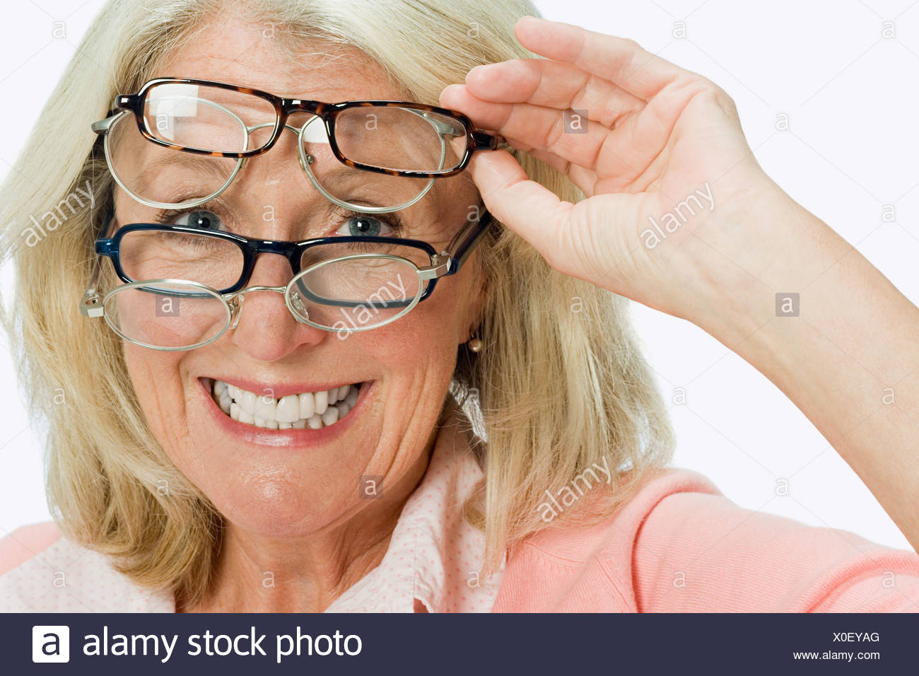 Woman wearing lots of glasses - Stock Image