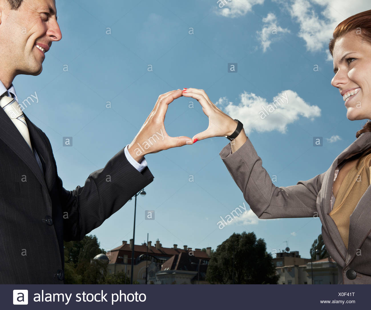 Business people making circle with hands - Stock Image