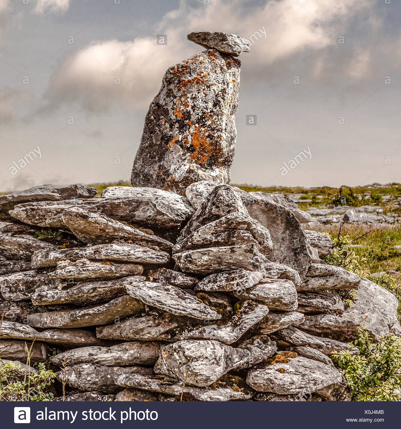 UK, Northern Ireland, Ulster, County Down, Newry, Burren, Two stones balanced on pile of rocks - Stock Image
